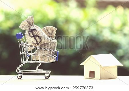 Home Loan, Mortgages, Debt, Savings Money For Home Buying Concept : Us Dollar Money Bag In Shopping
