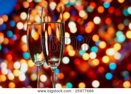 Glasses with champagne on an abstract background