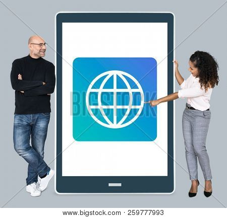 Diverse  people standing beside a tablet with www icon