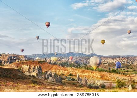 Many Colorful Balloons Take Off Into The Sky At Dawn. All The Sky In Big Beautiful Balloons. Fabulou