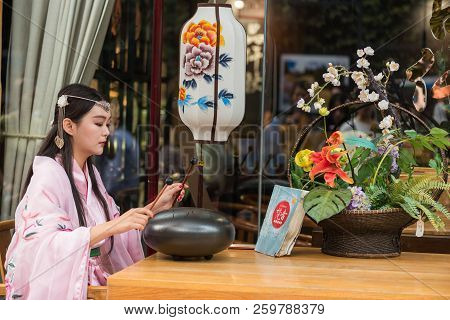 Chengdu, Sichuan Province, China - Oct 1st, 2017: Woman Wearing Traditional Clothes Playing Steel To