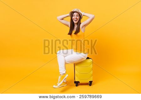 Traveler Tourist Woman In Summer Casual Clothes, Hat Sit On Suitcase Isolated On Yellow Orange Backg