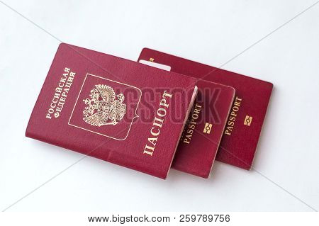 Three passport of the citizen of the Russian Federation on a white background. poster