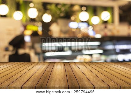 Wooden Board Empty Table And Blurred Or Defocus Background And Light Bulb Bokeh . Perspective Brown