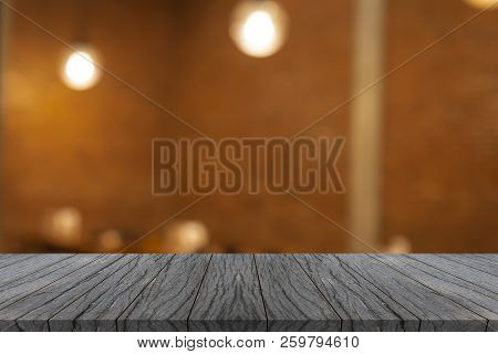 Wooden Board Empty Table Top Front Of Blurred Restaurant Background. Perspective Light Black Wood Ta