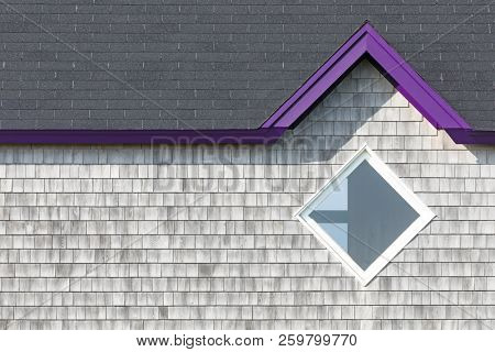 Detail of the facade of the typical wooden houses of Iles de la Madeleine, or the Magdalen Islands, in Canada. Minimalistic style in with purple accent and space for text.