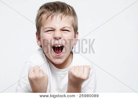 Happy boy football fan on light background