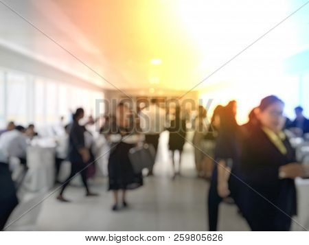 Abstract Blur Image Of Lunch Break Education People And Student In Line Wait For Food Meals From Tab