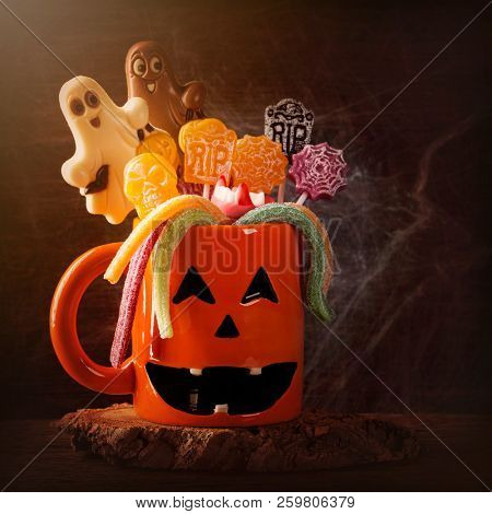 Pumpkin mug with sweets for halloween party