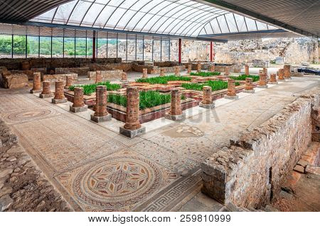 Condeixa-a-Nova, Portugal - July 8, 2017: Casa dos Repuxos or House of the Fountains in Conimbriga, one of the best preserved Roman cities on western Empire. Ornate mosaics, peristyle, garden and pond