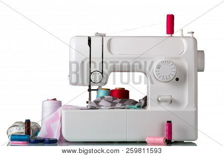 Electric Sewing Machine With Sewing Accessories Isolated On White Background