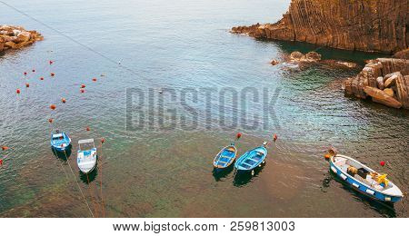 Typically Mediterranean Small Small Boats From High Point Of View Moored  On Mediterranean Sea In Ci