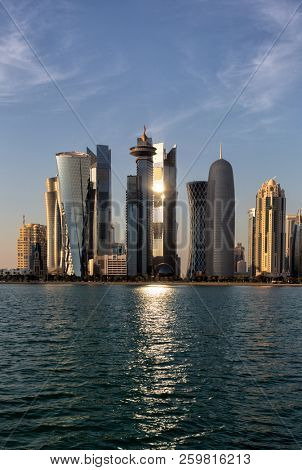 DOHA, QATAR - January 31, 2016: The setting sun reflects of one of the towers in Doha's high-rise commercial district