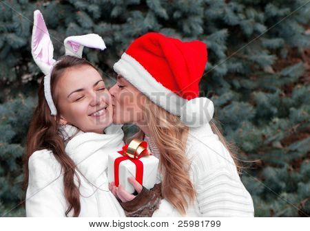Two cheerful girls twins, in the park