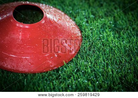 Cones in football field. Coath arranged colorful markers in trainning grassfield of football soccer stadium