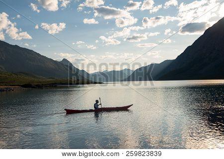 Jotunheimen National Park, Norway - 27 July, 2018: Man Kayaking At Gjende Lake, Besseggen Ridge, Jot