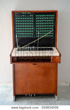 Old Telefon Switchboard In Front Of A White Wall
