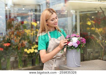 Female Florist Making Beautiful Bouquet In Flower Shop