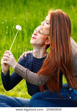 Portrait happy young teenage couple outdoor