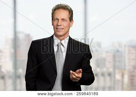 Thinking Businessman On Blurred Background. Mature Man In Formal Wear Having An Idea. Portrait Of Ha