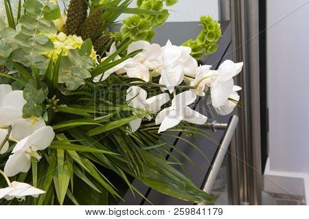 A Flower Arrangement On A Coffin In A Mortuary
