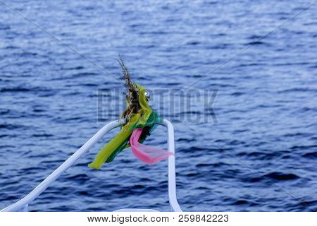 Three Colored Cloth Tied To The Boat.