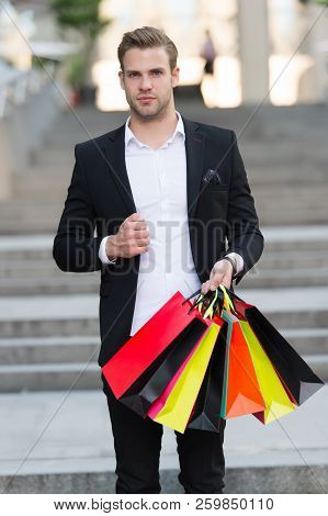 Man Formal Suit Carry Shopping Bags. Guy Carry Bunch Shopping Bags. Profitable Deals Shopping On Bla