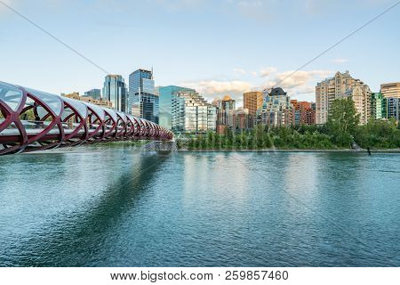 Skyline Of The City Calgary, Alberta, Canada Along The Bow River With Peace Bridge