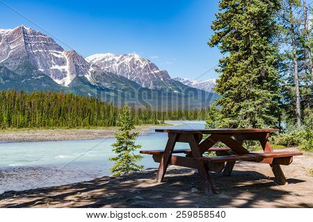 Picnic Table Along The Bow River In Jasper National Park, Alberta, Canada