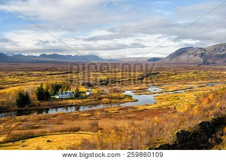 Haukadalur Valley In Iceland. Beautiful Landscape With River In Valley. Little Buildings In Peaceful