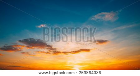 Sunset Sunrise Sky Background. Bright Dramatic Sky In Yellow, Orange And Blue Colors.