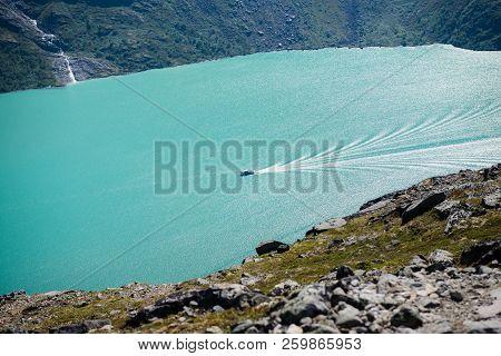 Besseggen Ridge Over Gjende Lake With Ship In Jotunheimen National Park, Norway