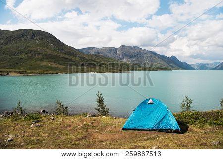 Blue Tent On Besseggen Ridge Over Gjende Lake In Jotunheimen National Park, Norway