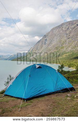 Camp Tent On Besseggen Ridge Over Gjende Lake In Jotunheimen National Park, Norway