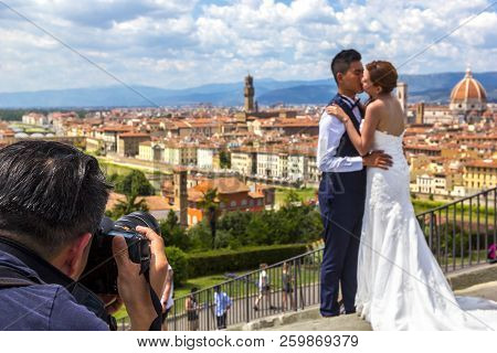 Florence, Italy-june 27, 2018:photographer Shoots An Asian Wedding Pair, Bridegroom And Bride Admire