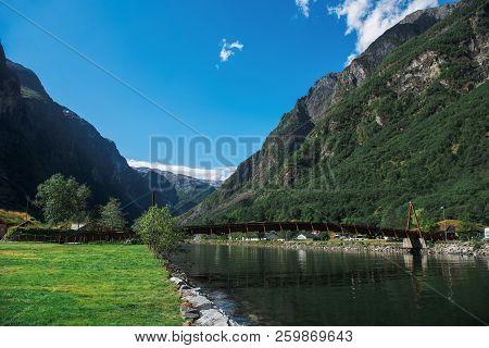 Bridge Over River With Mountains In Gudvangen, Neirofjord, Norway