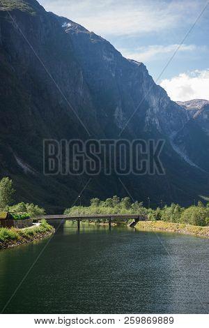 Bridge Over Lake With Mountains In Gudvangen, Neirofjord, Norway