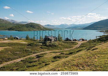 Wooden Buildings In Cozy Village At Gjende Lake, Besseggen Ridge, Jotunheimen National Park, Norway