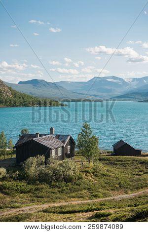 High Angle View Of Wooden Buildings On Coast Of Beautiful Gjende Lake, Besseggen Ridge, Jotunheimen