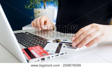 Closeup Image Of Wife Trying To Guess Password For Credit Cards