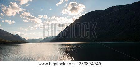 Majestic Landscape With Mountains Reflected In Calm Water Of Gjende Lake, Besseggen Ridge, Jotunheim