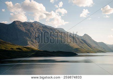 Beautiful Mountains Covered With Green Vegetation And Majestic Gjende Lake, Besseggen Ridge, Jotunhe