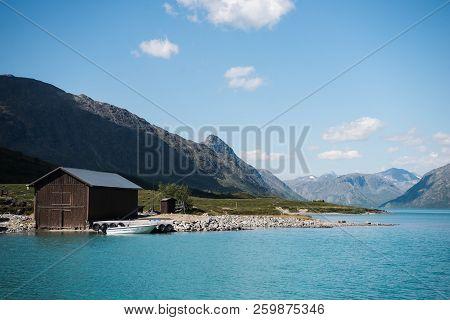 Wooden Barn And Boat On Coast Of Majestic Gjende Lake, Besseggen Ridge, Jotunheimen National Park, N