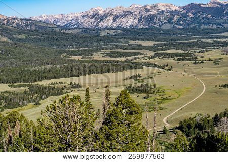 Beautiful Valley Mountain View With A Winding Dirt Road In The Frank Church Wilderness Of Idaho