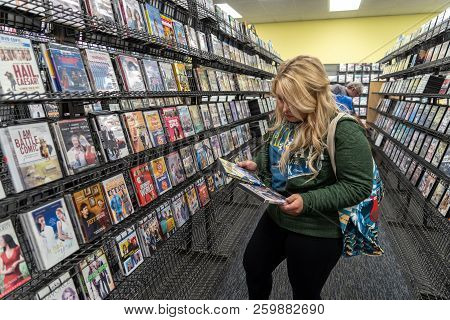 August 12 2018 - Fairbanks, Ak: Blonde Woman Customer Shops For Dvd Rentals Inside Of One Of The Las