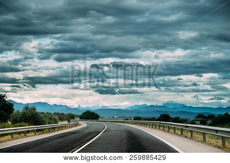 Beautiful Open Road Asphalt Freeway, Motorway, Highway Against The Background Of Pyrenees Mountains