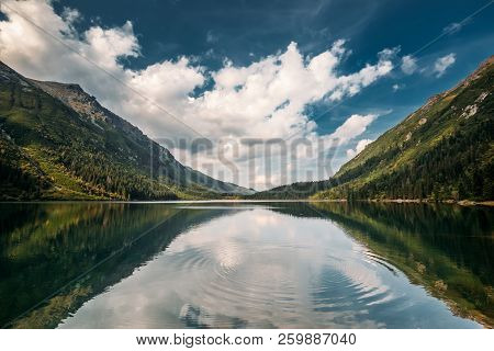 Tatra National Park, Poland. Circles On Water On Surface Of A Calm Lake. Famous Mountains Lake Morsk