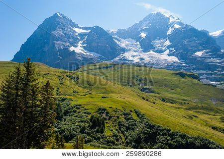 Beautiful Summer Mountain Landscape With Views Of Eiger Peak And Menh Peak. Bernese Oberland, Switze