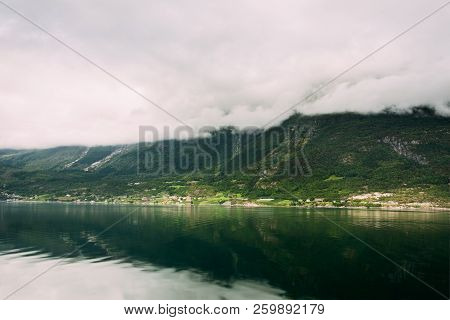 Hardangerfjord, Norway. Summer Landscape With Scandinavian Village On Shore Of Hardangerfjord. Harda