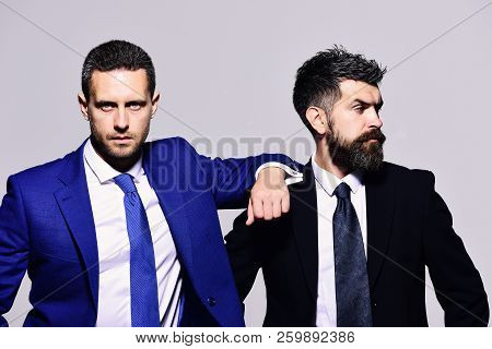 Business, Confidence And Teamwork Concept. Businessmen With Confident Faces